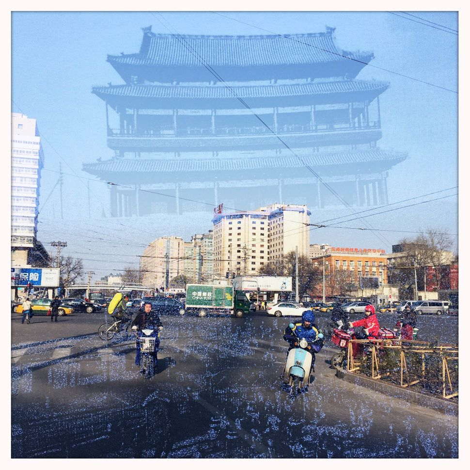 Chongwenmen Gate Tower, which was demolished in 1968, is superimposed on an image of Chongwenmen area, which now has many sho