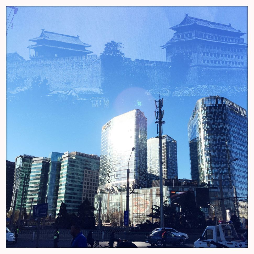 Dongzhimen Gate Tower, which was demolished in 1965, is superimposed on a photo of Dongzhimen area, now a popular shopping di