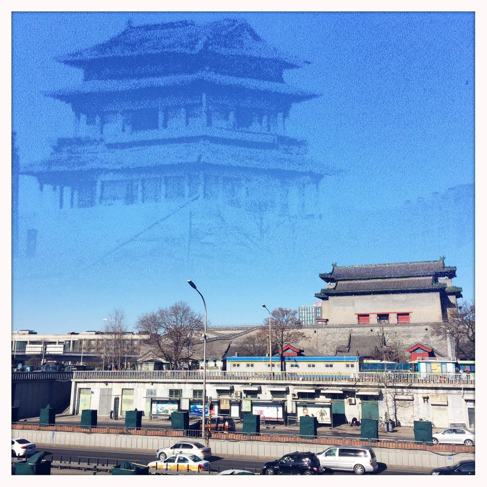 An image of the original Deshengmen Gate Tower, which was demolished in 1921, is superimposed onan image of an existing