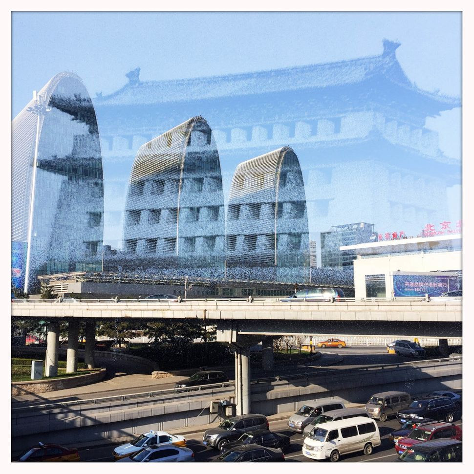The image of the demolishedXizhimen Gate Tower, which was destroyed in 1969, is superimposed on one of Xizhimen area, a