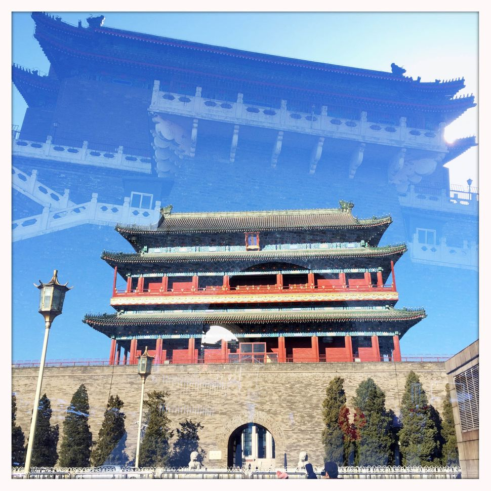 The Zhengyangmen gate tower is superimposed on an image of the embrasured Zhengyangmen gate tower, located at the southern&nb