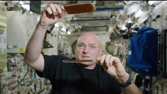 Astronaut Scott Kelly plays ping pong with water.