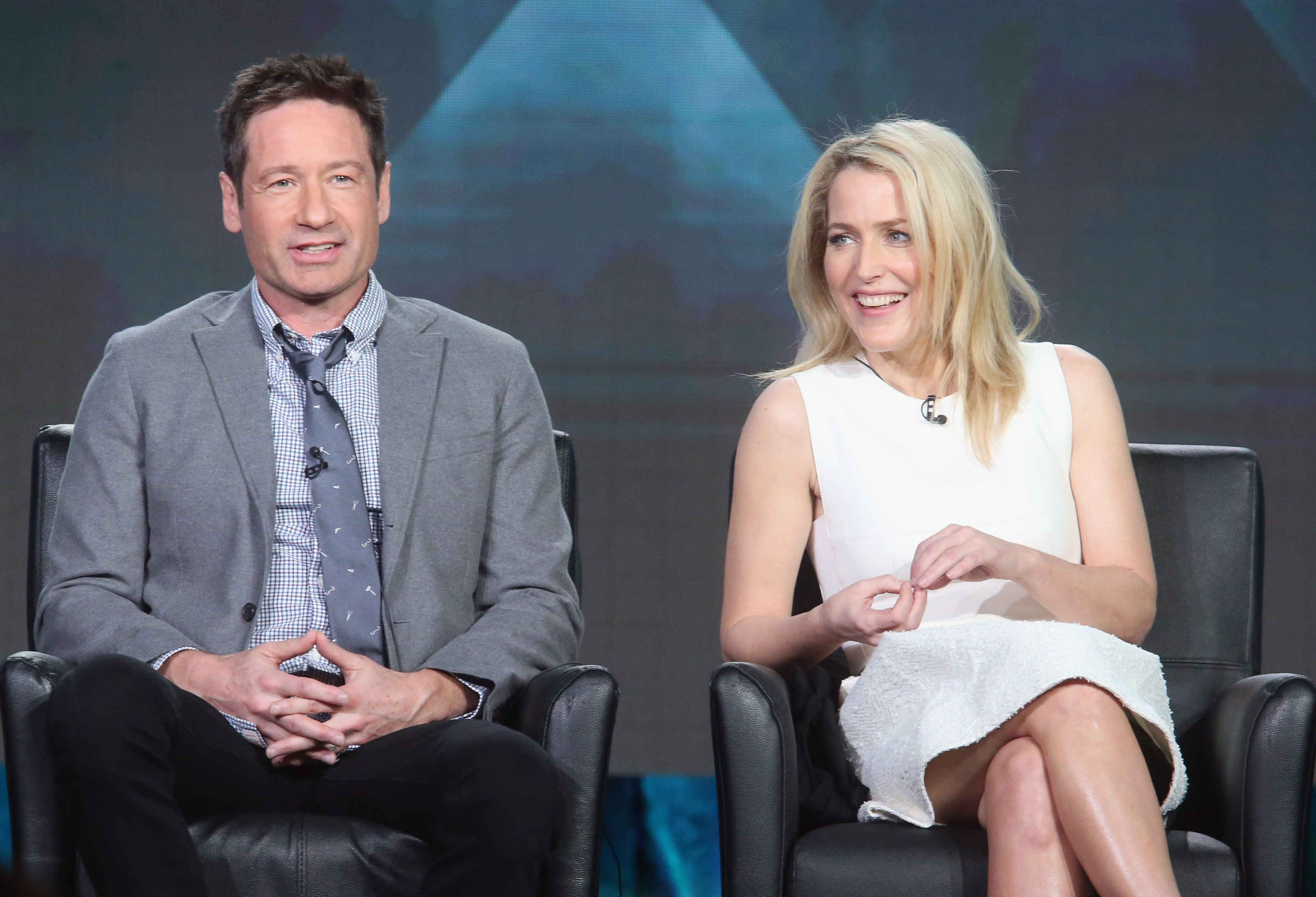 PASADENA, CA - JANUARY 15:  Actors David Duchovny and Gillian Anderson speak onstage during 'The X-Files' panel discussion at the FOX portion of the 2015 Winter TCA Tour at the Langham Huntington Hotel on January 15, 2016 in Pasadena, California  (Photo by Frederick M. Brown/Getty Images)