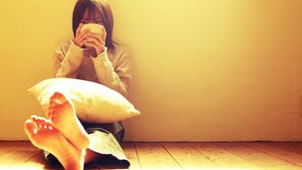 Woman Sitting On Floor And Drinking Coffee