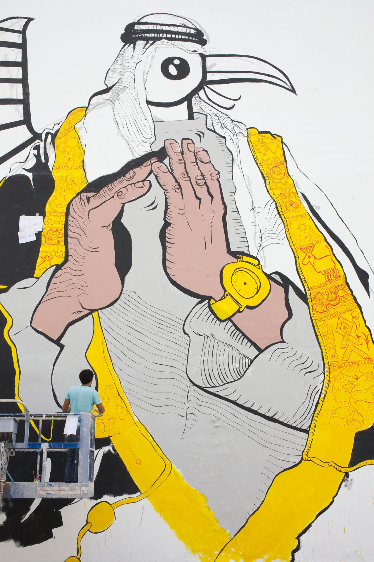 Ganzeer is known for his murals that blend current cultural images with traditional symbols, such as the one pictured here in Bahrain in 2014.