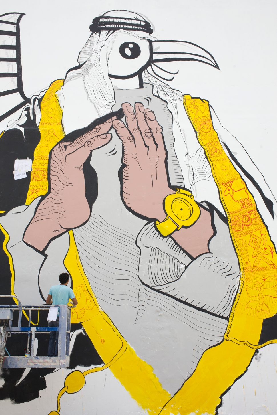 Ganzeer is known for his murals that blend current cultural images with traditional symbols, such as the one p