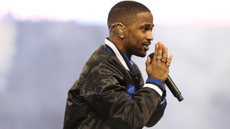 DETROIT MI - NOVEMBER 26: Big Sean performs during the half time show of the Detroit Lions vs. Philadelphia Eagles Thanksgiving Day Game on November 26, 2015 at Ford Field in Detroit, Michigan.(Photo by Leon Halip/Getty Images)
