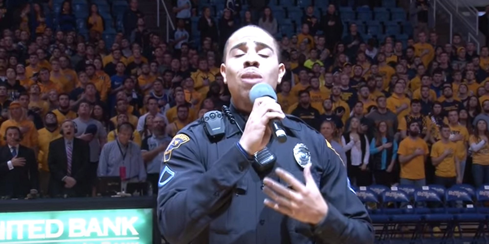 west virginia university pictures videos breaking news cop steps in to sing national anthem when performer can t make it slays in uniform