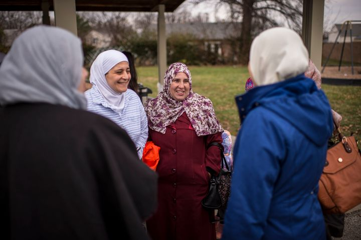 Awoman who fled Syria 4 years ago at a potluck at Norfolk Acres Park in Louisville, KY.