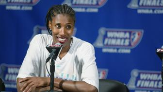 LOS ANGELES - AUGUST 31:  Lisa Leslie #9 of the Los Angeles Sparks talks to the press after Game two of the 2002 WNBA Finals against the New York Liberty on August 31, 2002 at Staples Center in Los Angeles, California.  The Sparks won 69-66.  NOTE TO USER: User expressly acknowledges and agrees that, by downloading and/or using this Photograph, User is consenting to the terms and conditions of the Getty Images License Agreement.  Mandatory copyright notice: Copyright 2002 WNBAE  (Photo by: Scott Quintard)/WNBAE/Getty Images)