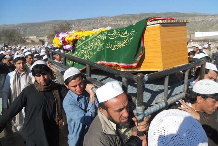 Mourners carry the coffin of one of the 21 Pakistanis killed at Bacha Khan University, Jan. 20, 2016. The incident has w