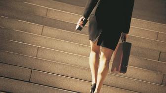 Businesswoman ascending stairs