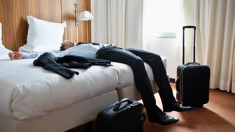 Businessman Sleeping in Motel Room