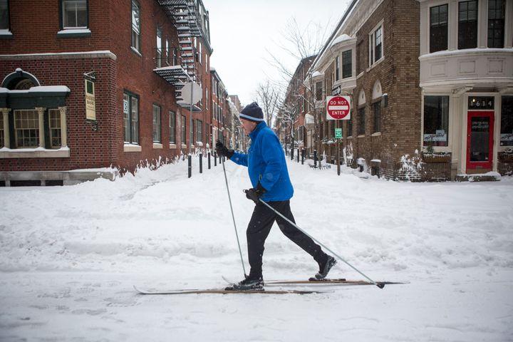 A man skies through downtown Philadelphia as snow continues to fall on Jan. 23, 2016 in Philadelphia, Pennsylvania.
