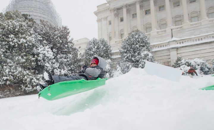 Sledders took to the slopes of the West Front of the Capitol on Saturday morning, Jan. 23, 2016 in Washington, DC.