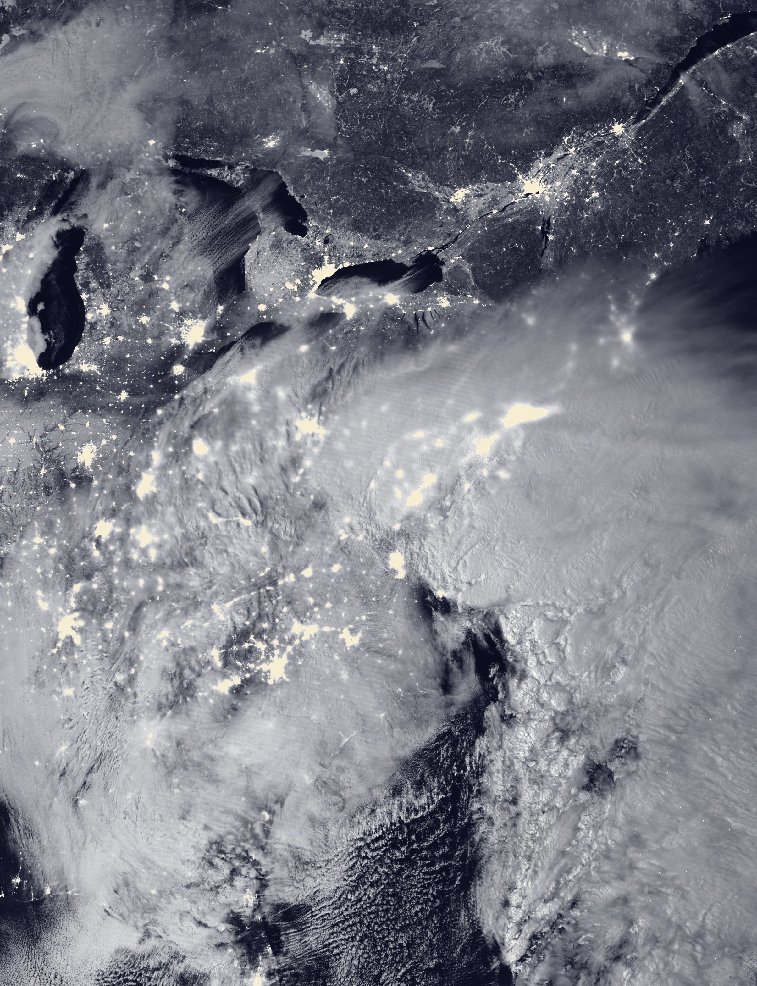 Two low-pressure systems are seen merging over the East Coast around 2 a.m. Saturday in this satellite image.