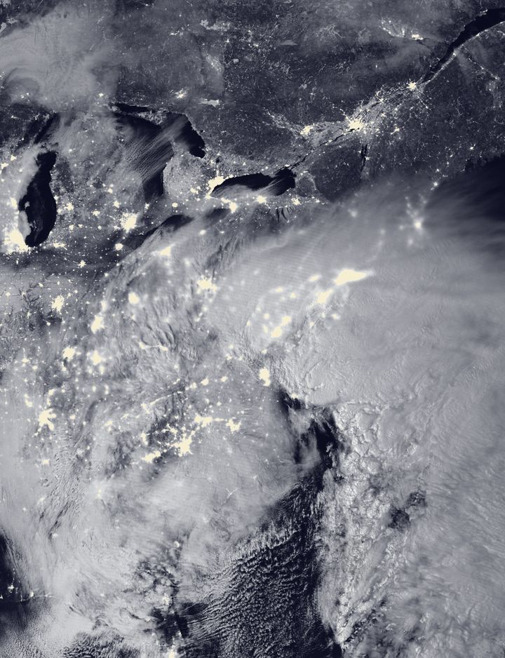 Twolow-pressure systems are seen merging over the East Coast around 2 a.m. Saturday in this satellite image.