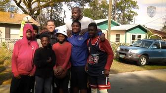 NBA legend Shaquille O'Neal dropped in for a neighborhood basketball game between local children and police officers on Saturday.