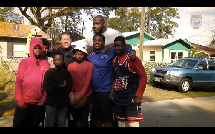 NBA legend Shaquille O'Neal dropped in for a neighborhood basketball game between local children and police officers on Satur