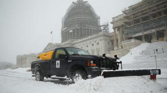 WASHINGTON, DC - JANUARY 23:  A snowplow clears snow on the East Front of the U.S. Capitol January 23, 2016 in Washington, DC. Heavy snow continued to fall in the Mid-Atlantic region causing 'life-threatening blizzard conditions' and affecting millions of people.  (Photo by Alex Wong/Getty Images)
