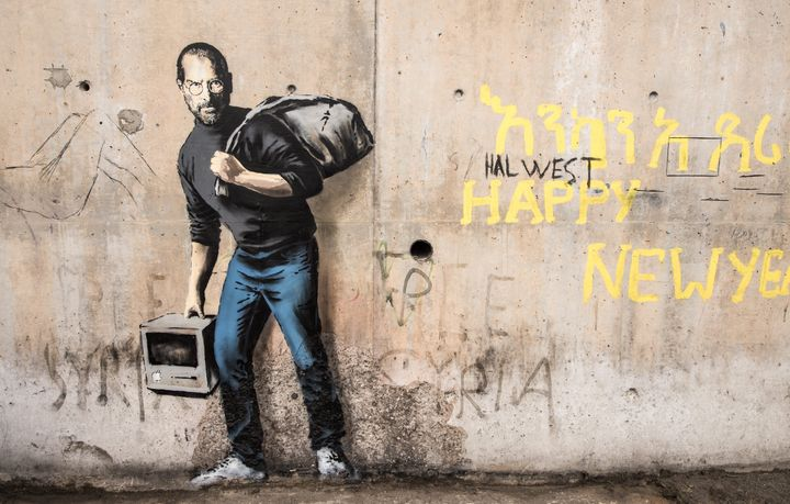 This picture taken on Dec. 12, 2015 shows a street art graffiti representing Steve Jobs, founder and late CEO of Apple, by el