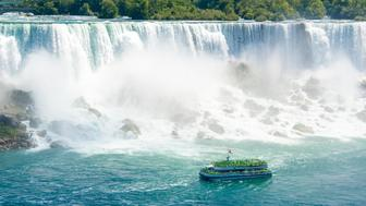 The new Hornblower Cruise passing in front of the American Fall in Niagara Falls.