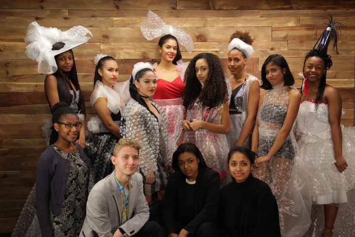 The Fashion With A Purpose Club students modeling their designs, post-fashion show.