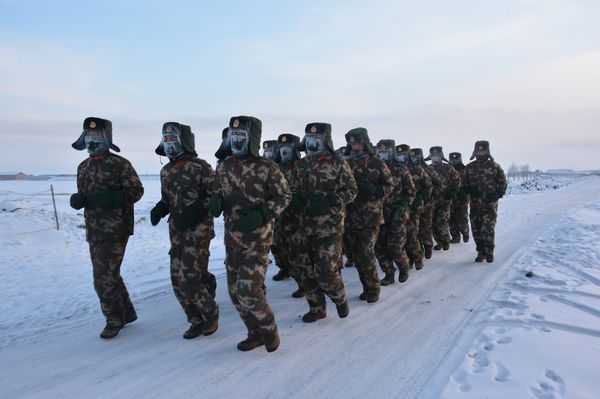 Frontier soldiers take part in physical training exercises in the snow in Hulunbuir, Inner Mongolia, on Jan. 19.