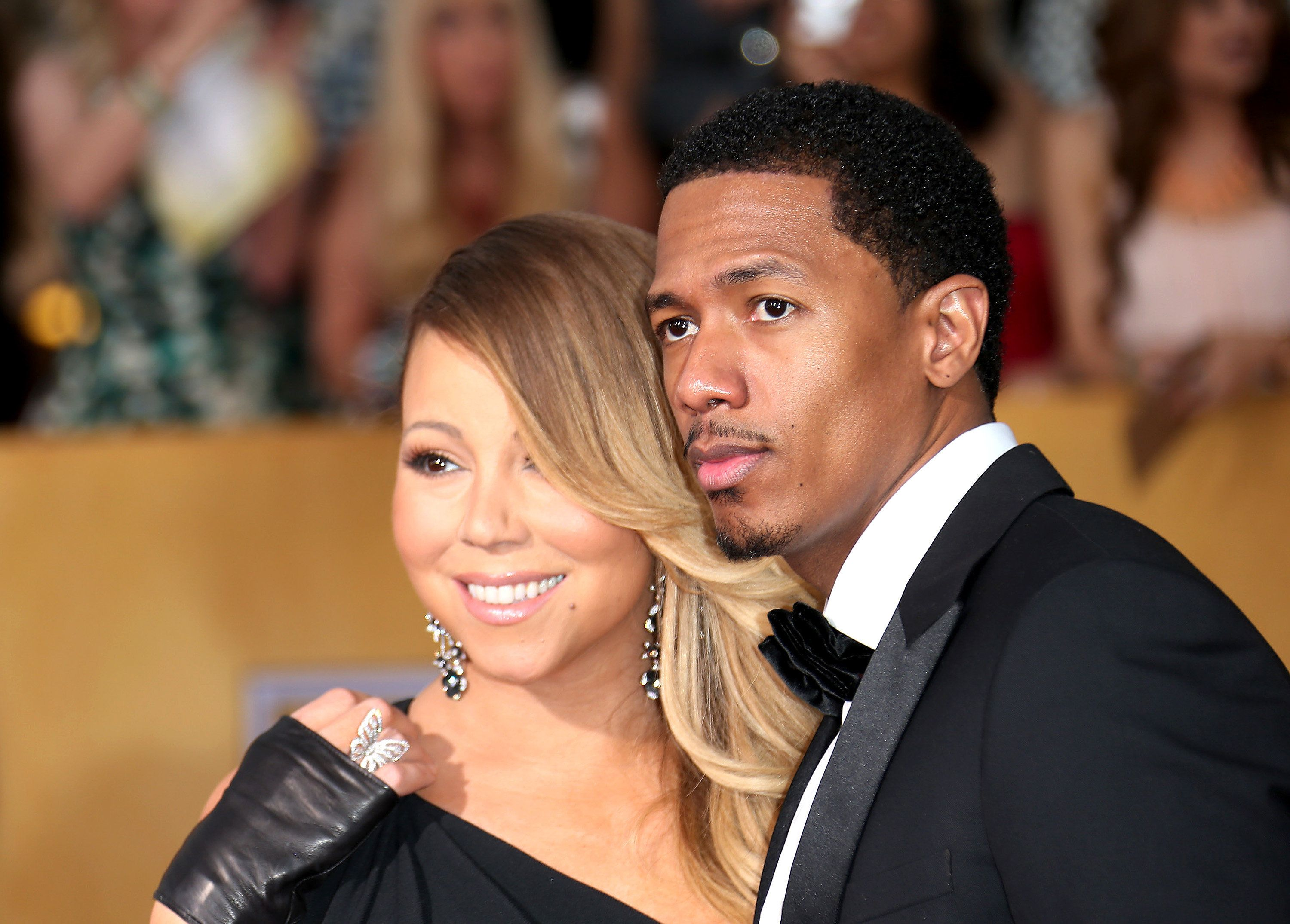 LOS ANGELES, CA - JANUARY 18: Mariah Carey and Nick Cannon (R) arrive at the 20th Annual Screen Actors Guild Awards at the Shrine Auditorium on January 18, 2014 in Los Angeles, California. (Photo by Dan MacMedan/WireImage)