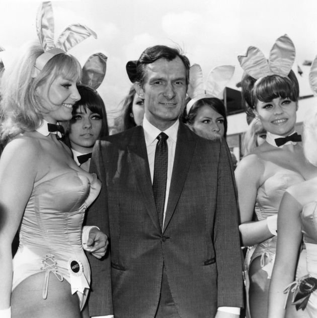 Playboy editor and tycoon Hugh Hefner is greeted by a group of Bunnies from his Playboy Clubsas...