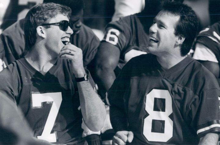 Now coach Gary Kubiak as a member of the Denver Broncos. Kubiak is pictured here next to teammate John Elway.