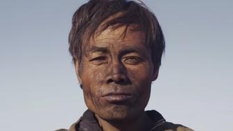 "A coal miner in Zhao Liang's documentary ""Behemoth""."