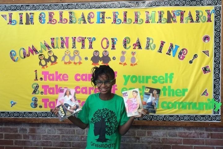 Marley Dias poses enthusiastically at a book drive at Lingelbach Elementary School in Philadelphia.