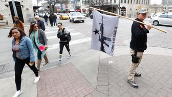 AUSTIN, TX - JANUARY 1: James Singer of south Texas takes part in a public walk around downtown Austin after an open carry gun rally. On January 1, 2016, the open carry law takes effect in Texas, and 2nd Amendment activists hold an open carry rally at the Texas State Capitol on January 1, 2016 in Austin, Texas. (Photo by Erich Schlegel/Getty Images)