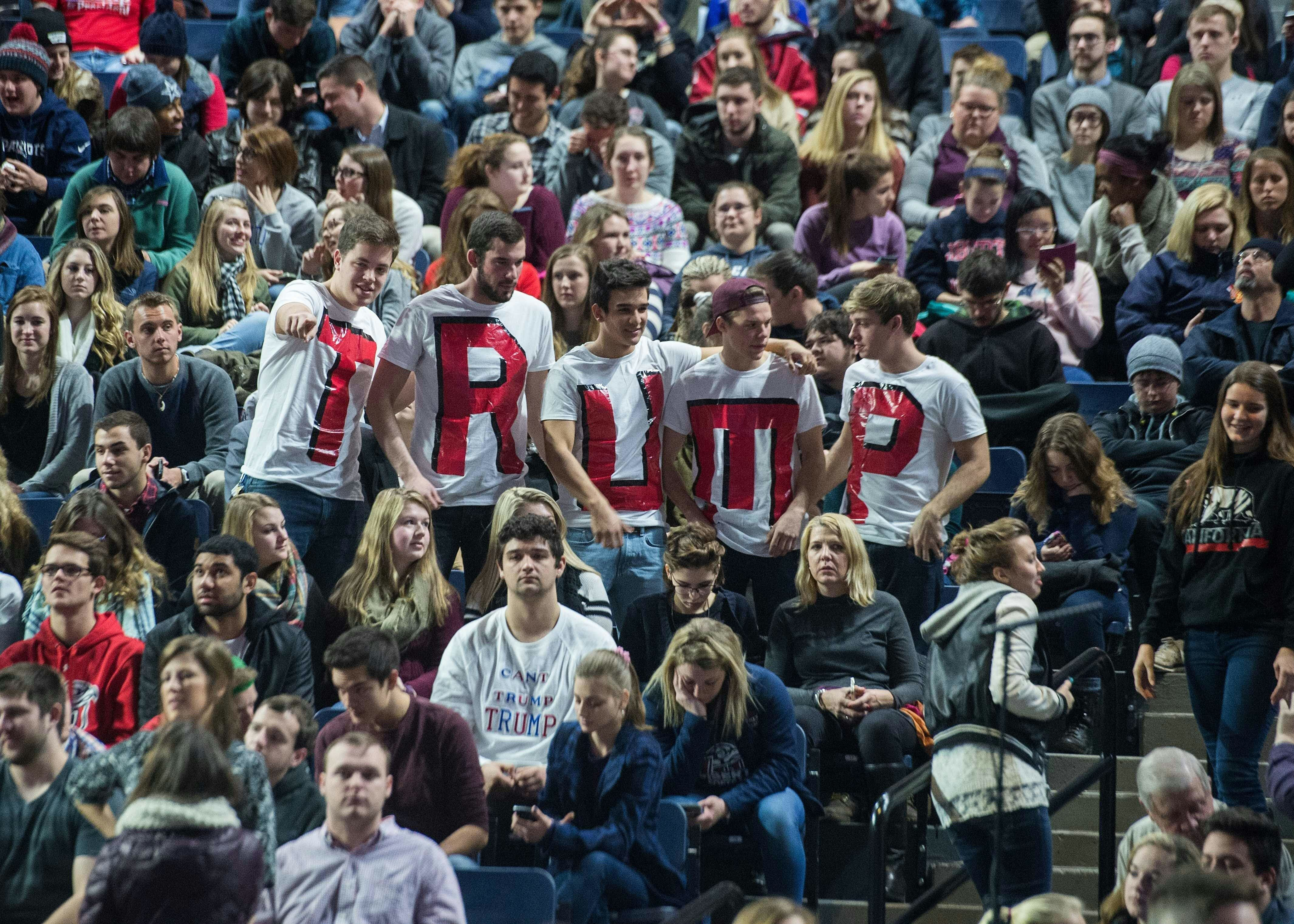 Supporters of Republican presidential candidate Donald Trump attend a rally at Liberty University in Lynchburg, Virginia, on
