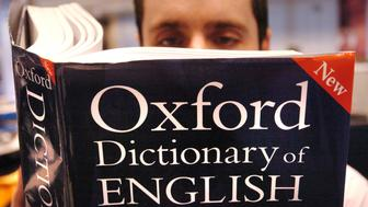 Embargoed to 0001 Thursday March 15  PICTURE POSED BY MODEL. A man reads a copy of the Oxford Dictionary of English.