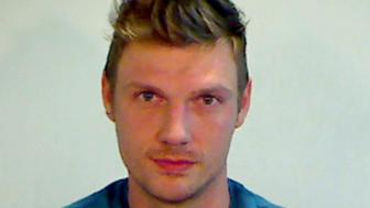 KEY WEST, FL - JANUARY 13:  (EDITORS NOTE: Best quality available) In this handout photo provided by the Key West Police Department, singer Nick Carter of the Backstreet Boys is seen in a police booking photo after his arrest for misdemeanor battery January 13, 2015 in Key West, Florida.  The arrest followed and incident at Hogs Breath Saloon in Key West after Carter and another man he was with were allegedly in an altercation with employees of the bar.  (Photo by Key West Police Department via Getty Images)