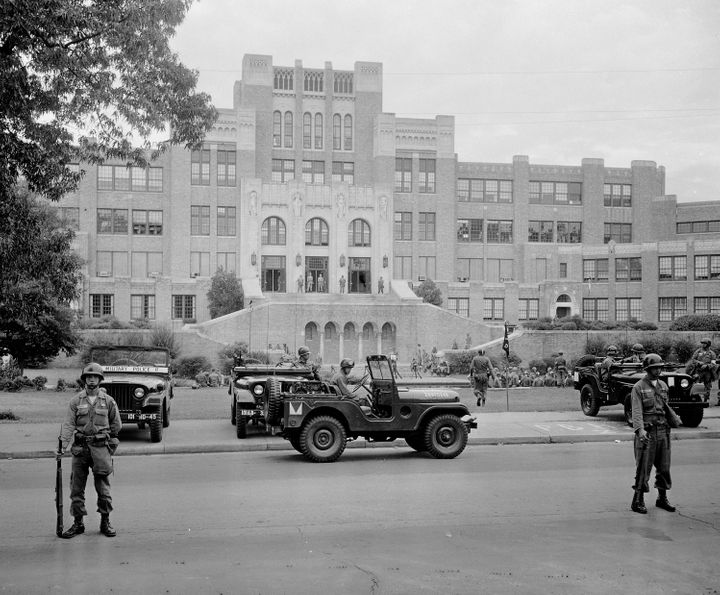 Members of the 101st Airborne Division take up positions outside Central High School in Little Rock, Arkansas, in September 1