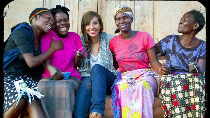 <i>Frenkel (</i>center<i>) in 2011, meeting with entrepreneurs in Uganda</i>
