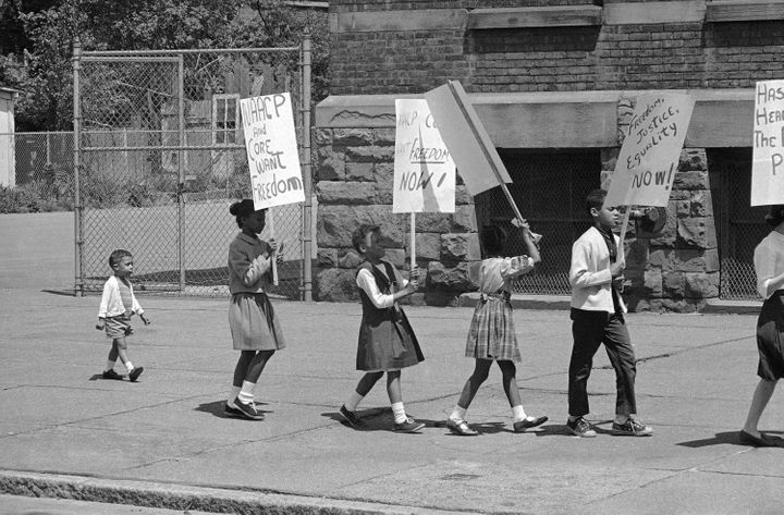 A civil rights demonstration in 1964 commemorates Brown v. Board of Education.
