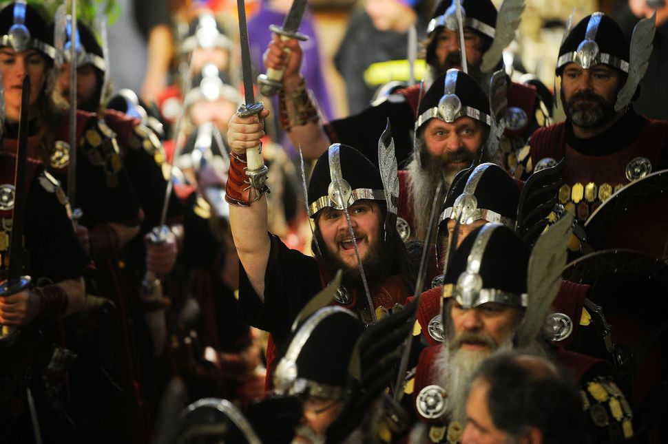 Participants gather in Viking attire for the annual Up Helly Aa festival in Lerwick, Shetland Islands, on