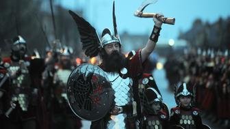 Participants dressed as Vikings process in the street before the annual Up Helly Aa festival in Lerwick, Shetland Islands, on January 26, 2016. Up Helly Aa celebrates the influence of the Scandinavian Vikings in the Shetland Islands and culminates with up to 1,000 'guizers' (men in costume) throwing flaming torches into their Viking longboat and setting it alight later in the evening. / AFP / Andy Buchanan        (Photo credit should read ANDY BUCHANAN/AFP/Getty Images)