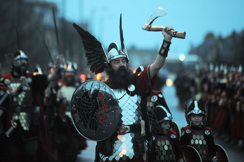 Participants dressed as Vikings fill the street for the annual Up Helly Aa festival in Lerwick, Shetland Islands, o