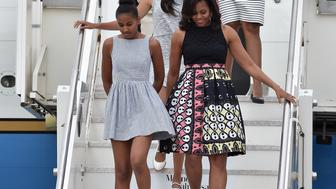 MILAN, ITALY - JUNE 17:  First Lady Michelle Obama arrives with daughters Malia Obama (C) and Sasha Obama (L) and her mother Marian Robinson (behind Malia) at Malpensa Airport on June 17, 2015 in Milan, Italy.  (Photo by Jacopo Raule/Getty Images)