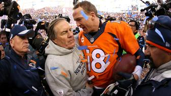 DENVER, CO - JANUARY 24:  Peyton Manning #18 of the Denver Broncos and head coach Bill Belichick of the New England Patriots speak after the AFC Championship game at Sports Authority Field at Mile High on January 24, 2016 in Denver, Colorado. The Broncos defeated the Patriots 20-18.  (Photo by Doug Pensinger/Getty Images)