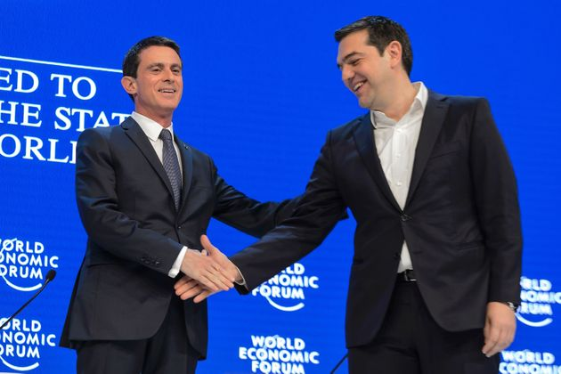 An ally against the IMF?French Prime Minister Manuel Valls, left, shakes hands with Greek Prime...