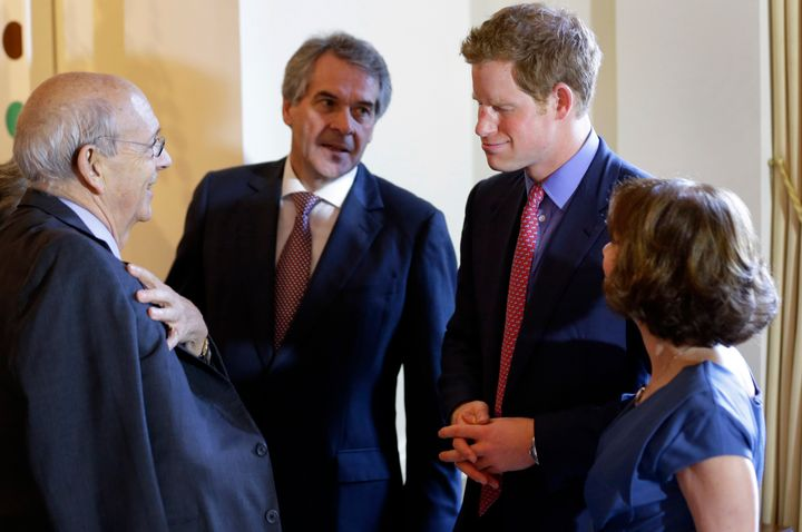 Supreme Court Justice Stephen Breyer (far left) chatswith Sir Peter Westmacott, Prince Harry and Lady Susie Westmacott