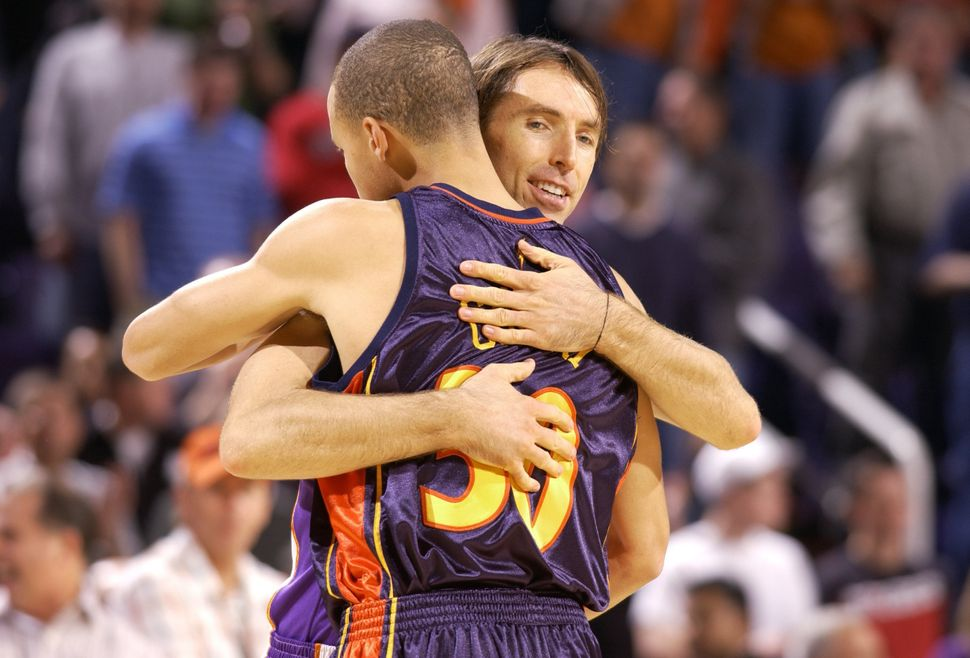 Nash greets a rookie Stephen Curry after the Suns defeated the Warriors, 123-101, on Oct. 30, 2009, in Phoenix, Arizona.