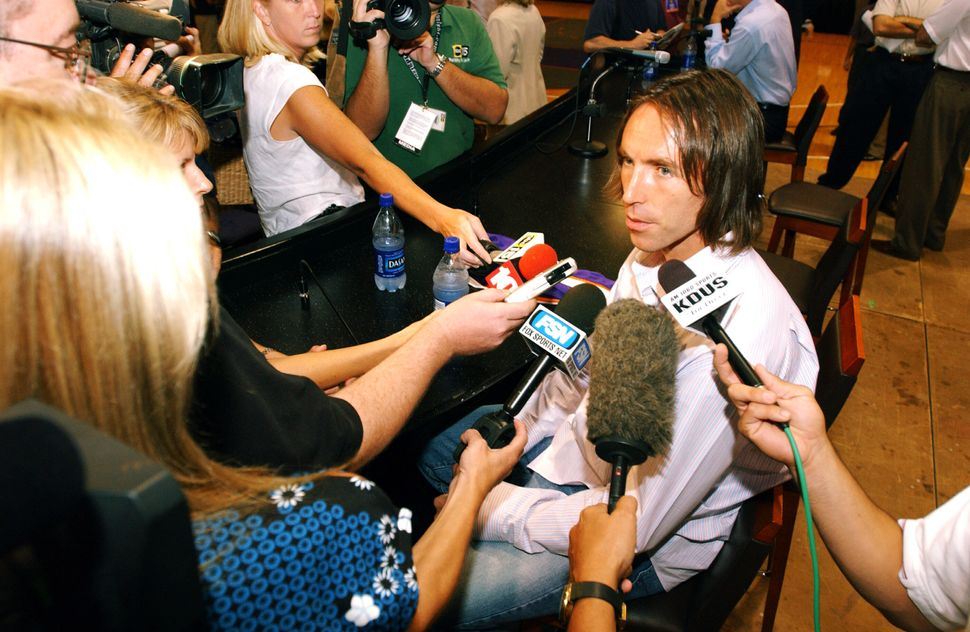 A young Steve Nash speaks with the media after agreeing to rejoin the Phoenix Suns on July 14, 2004, at America Wes