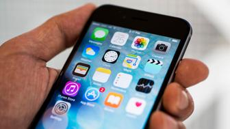 The home screen is displayed on an Apple Inc. iPhone 6s smartphone in an arranged photograph in Hong Kong, China, on Friday, Sept. 25, 2015. The latest models, following last year's hugely popular design overhaul that added bigger screens, may not match the success of previous releases, according to analysts. Photographer: Xaume Olleros/Bloomberg via Getty Images